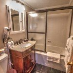 Honeymoon Suite Bath With Jetted Tub And Antique Vanity